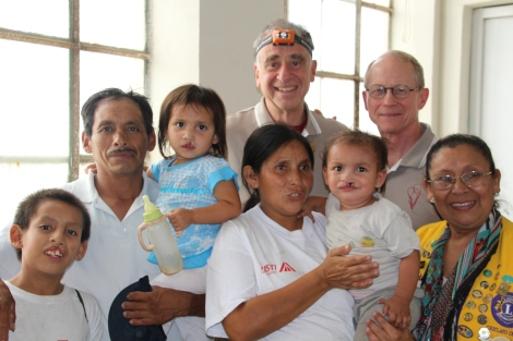 Jerson Yodan, age 14; Geibi, age 4; and Deiler Carlos, age 2, along with their parents and Dr. Tom Albert and Kelly Jensen before surgery.